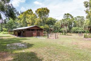 Casa Unifamiliar por un Alquiler en Loxahatchee Groves, 13101 Collecting Canal Road Loxahatchee Groves, Florida 33470 Estados Unidos