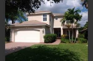 Casa Unifamiliar por un Alquiler en 5017 Solar Point Greenacres, Florida 33463 Estados Unidos