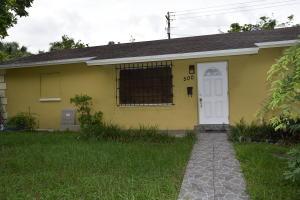 Casa Unifamiliar por un Alquiler en VILLAGE OF PALM SPRINGS, 500 Purdy Lane 500 Purdy Lane Palm Springs, Florida 33461 Estados Unidos