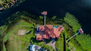 EXQUISITE, MAGNIFICENT LAKE SIDE FLORIDA, YET RENNAISSANCE STYLE LIKE ESTATE ON A CUL DE SAC, 4+ ACRES, ALMOST 8000 SQFT LIVING SPACE WITH A PRIVATE GATED 6 CAR GARAGE IN DR. PHILLIPS!!Approach property on a long paved and circular driveway towards the huge oak double doors with high ceiling porch. Interior space is open with dramatic views of Sand Lake from all sides of this piece of architecture. Foyer, defined living room spaces and formal dining awaits you. Exotic delicate wall and ceiling details surround you with predominantly gold trimmings and engraved decor. Very spacious and bright. The kitchen overlooks the family room and is a focal point of home with huge island, custom floor to ceiling cabinetry and overlay, 6 burner gas stove, dual ovens.