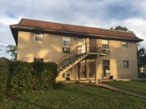 Maison avec plusieurs logements pour l Vente à 324 E Canal Street Belle Glade, Florida 33430 États-Unis