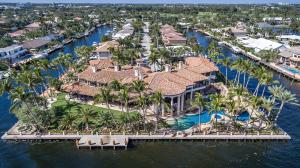 Built in 2004, by expert craftsman, this nearly 24,000 total square foot, 9 bedroom, 10 full and 6 half bath home encompasses one acre with 665' of waterfront on 3 sides. There's a resort size 102' pool complete with a swim up grilling station, rock waterfall, waterside, grotto and large sun shelf. Enter into the 2-story foyer with grand double staircase. To the right you will see the elevator, a half bath, formal living and dining rooms and his office, with working fireplaces in each room. To the left and located just off the fully-equipped chef's kitchen with breakfast nook and butler pantry, you enter into the 2-story Lodge-style gathering room with huge fireplace, wet bar and floor-to-ceiling windows offering breathtaking views. Down the hall, you'll find a TV room, office, poker