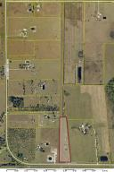 18.46 Acre tract consists of a 6.5 Acre homestead plus 5,170' x 100' wide runway shared with neighbor. Zoned and registered as a private airport with zoning approval for aircraft repair and maintenance. 1,500sq ft Manufactured home sits on huge salvaged bridge trusses over 26'6''x43'9'' Hangar/workshop. 50'x8' porches on front and back of home offer endless view of surrounding area. Large office could be built out as MBR, bath and closet.  A-frame cottage and concrete pad for pole barn. 15 min to Okeechobee. 30 min to Ft Pierce.