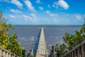 Welcome home to waterfront living at its finest!  This custom built 4 bedroom, 5.5 bathroom home is sure to impress.  The breathtaking views of the Indian River Lagoon are just the beginning.  This home boasts a dream kitchen with custom built wood cabinetry, Wolf/Sub-Zero appliances and impressive granite counter tops.  This home was built to entertain in pure style with a sunken bar, butlers pantry, double ovens, surround sound, and family/living areas that flow onto the the beautiful over sized custom pool, spa and outdoor kitchen. This property offers a 450' dock with boat lift, parking and power for an RV in the back driveway and grass areas engineered for overflow parking!
