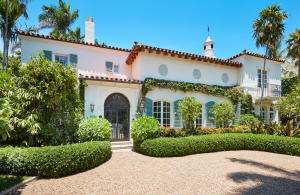 This gracious landmarked property, located in the Estate Section of Palm Beach, was designed by EB Walton in 1926.  The Mediterranean style residence offers 7,116 total square feet with exquisite details of painted tiles, pecky cypress woodwork, iron railings and an impressive living room with a soaring ceiling and fireplace.   The main house has a formal entry hall, library, loggia, bar, pecky cypress paneled dining room, large updated kitchen as well as four bedrooms and three and half baths.   A guest house is located across the pool with a 2-car garage, laundry room and storage downstairs and an apartment with a living room, kitchen and bedroom with full bath upstairs.