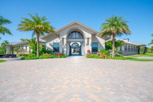 Location, Location, Location!! This is your opportunity to purchase the most complete breathtaking 10 acre equestrian property in Palm Beach Point. Located by the bridge to Grand Prix Village and just a short hack to the Palm Beach International Equestrian Center. The 24-stall center aisle barn is well designed by a true horseman. It includes 2-tack rooms, 2-laundry rooms, 2-hay, feed & storage rooms, 3-bathrooms, owners lounge with full bath, owners office, 8-wash - grooming stalls, and a  dedicated vet-farrier stall. There is a beautiful 4-bedroom owners home with attached garage & carport plus a separate 4 bedroom staff quarters. The pristine grass jump field with hill is adjacent to the oversized riding arena and 10 paddocks.