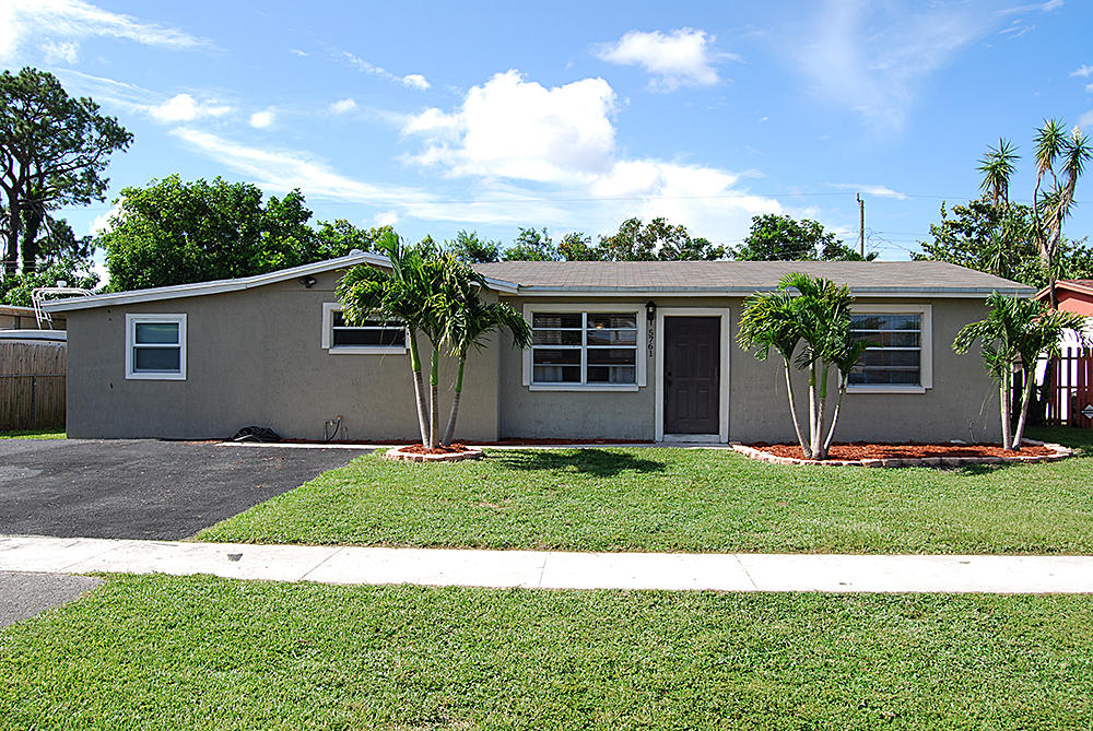 Home for sale in FOREST HILL VILLAGE 8 West Palm Beach Florida