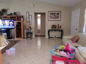 1036 SW ESTAUGH AVENUE, PORT SAINT LUCIE, FL 34953  Photo