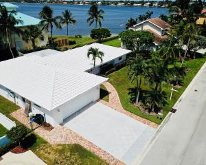 Spectacular views of the intracoastal from your own private pool with hot tub and screened in porch. Close to the beach and Keylime house restaurant, Boat ramp, and shopping. Renovated tastefully with wood floors throughout granite counter tops white cabinetry and stainless steel appliances. Views of the water from the  master Bedroom , and Master Bath featuring his and her sinks and nicely finished cabinetry large shower with rain style shower head. Guest Bath has a unique real stone finish with shower glass enclosure. Bonus den room set for a nice office or cozy tv room. Plenty of space with the laundry and hallway bath leading to a two car garage. Come live by the water and see the views live the lifestyle.