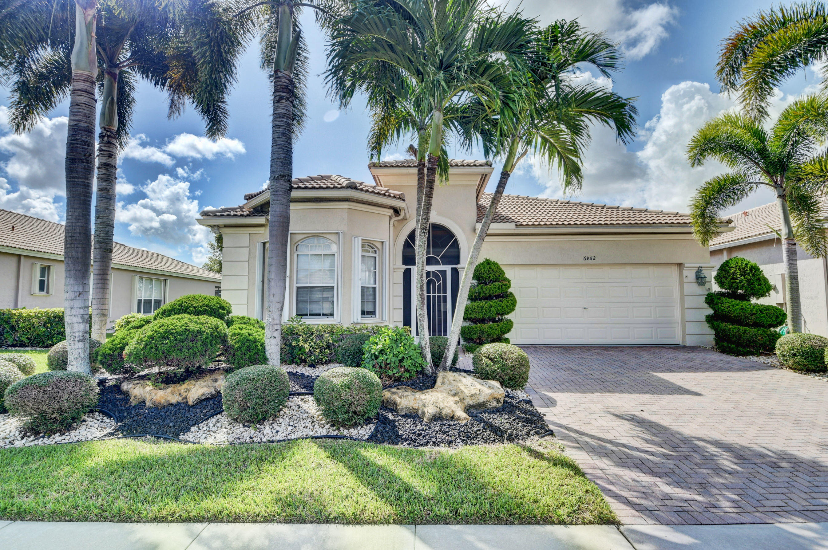 Photo of home for sale at 6862 Southport Drive, Boynton Beach FL
