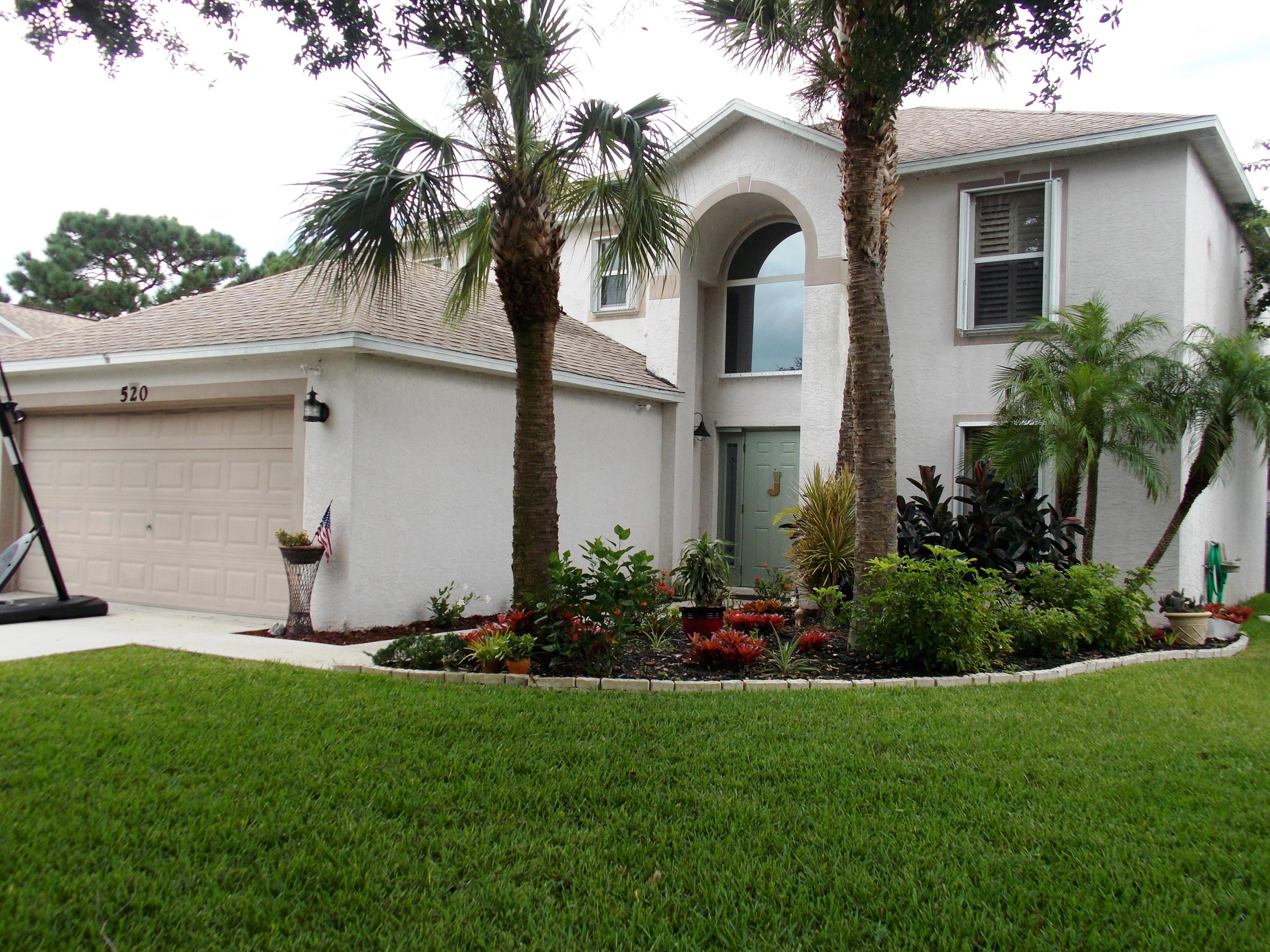 Photo of home for sale at 520 Deer Run SW, Port Saint Lucie FL