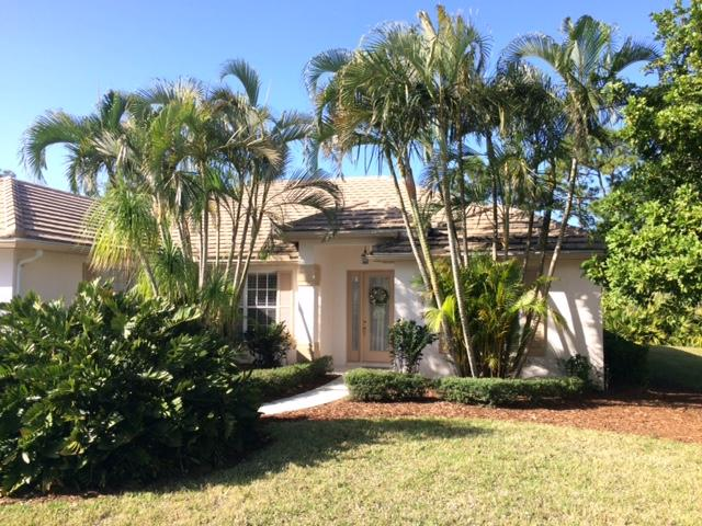 Photo of home for sale at 692 Whisper Ridge Trail SW, Palm City FL