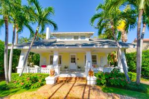 In town Palm Beach perfection! Enjoy Ocean breezes from the front porch of this charming completely renovated mission style home. Impact glass, en suite baths in each bedroom, large closets, guest house with kitchen, 2 beds and bath. Walk to restaurants, beaches, lake trail, the Brazilian Court and Worth Avenue! Turn key home.