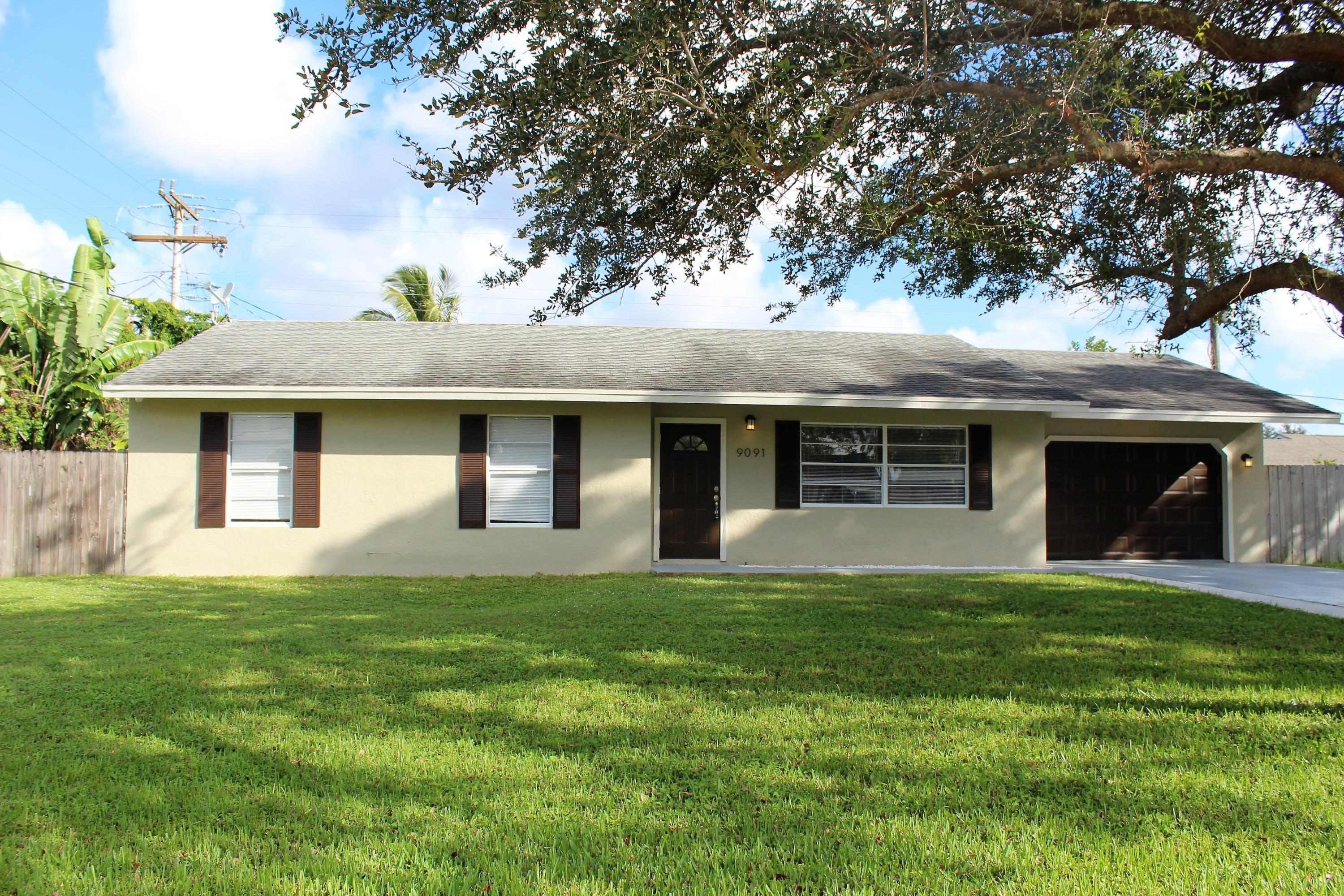 Home for sale in TROPICAL COUNTRY ESTATES Lake Worth Florida