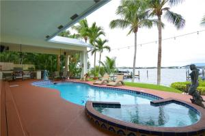 519 SW South River Point Drive , Stuart FL 34994 is listed for sale as MLS Listing RX-10487206 57 photos