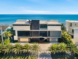 Rising above the ocean, this over 14,000 total square foot masterpiece, 120 feet on the  ocean and completed in 2018, is sited on approximately .65 of a beachfront acre in Highland Beach, FL. The residence consists of 7 bedrooms/7 full & 2 half baths on 3 levels of architectural design + a large rooftop sun deck. The ground  floor, which is built 17 feet above the sea, has air conditioned  parking for up to 8 vehicles, 4 ensuite  bedrooms, a game room & powder bath. The 2nd level has 2 full kitchens, family room, living room & full bar area. All of these main rooms have unobstructed ocean views. The luxurious oceanfront master suite on the 3rd level has a separate area for relaxing, indoor/outdoor private shower & hot tub, and a private office with 180 degree view of the Atlantic Ocean