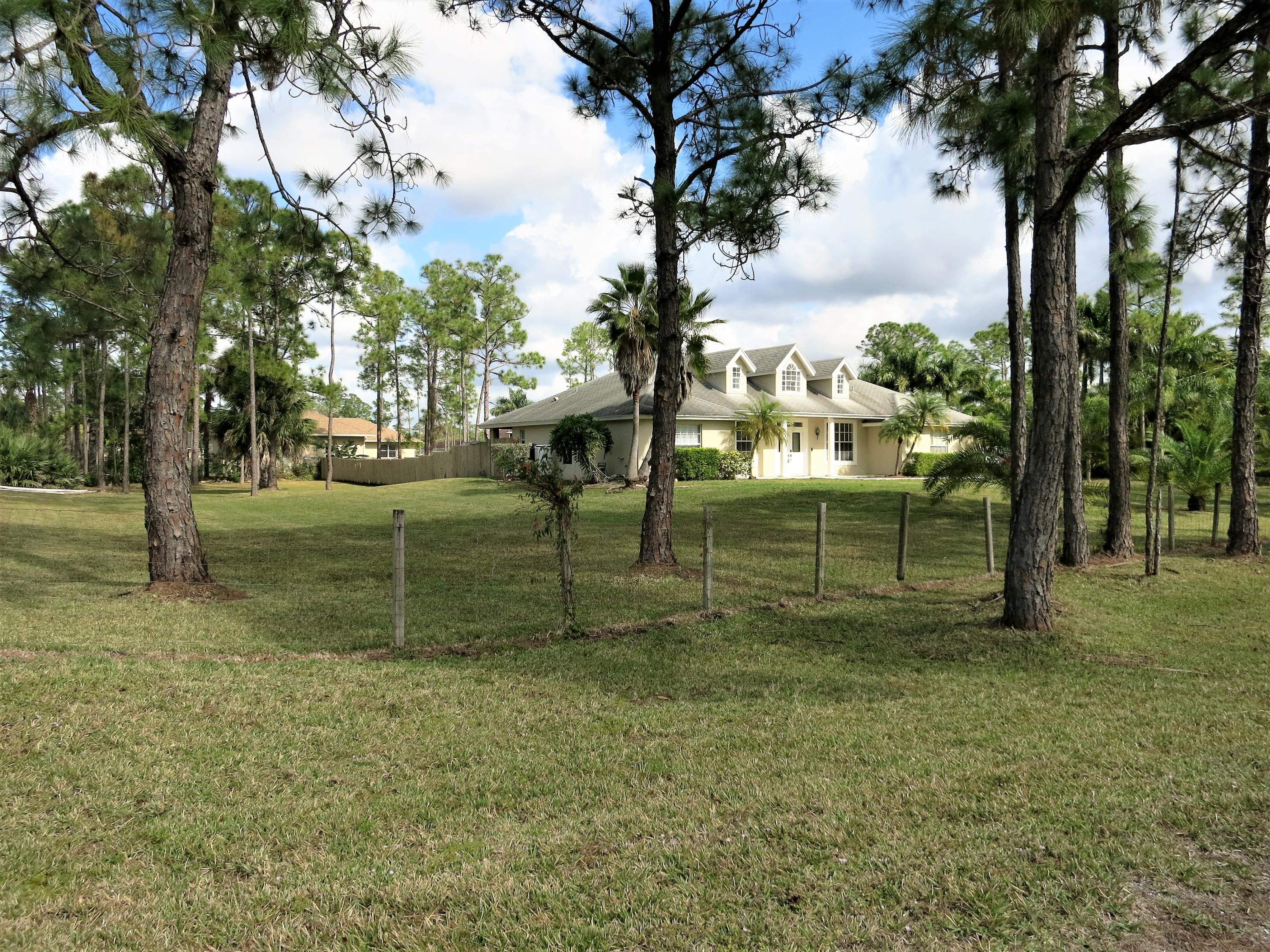 Photo of home for sale at 17977 78th Road, Loxahatchee FL
