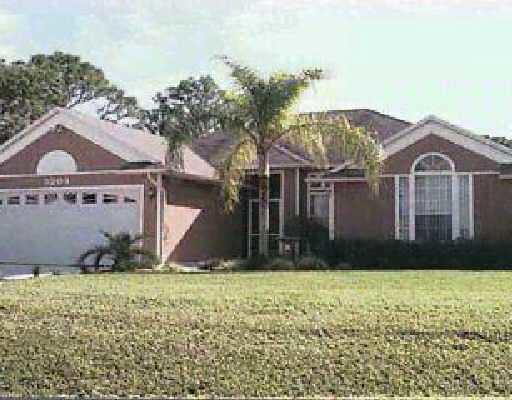 Photo of home for sale at 3204 Quay Street SE, Port Saint Lucie FL