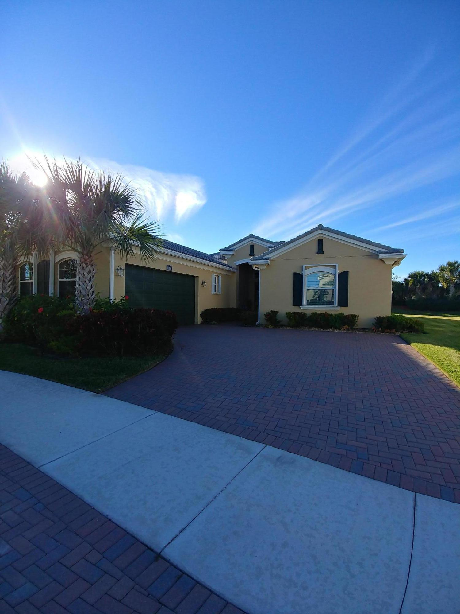 Photo of home for sale at 11381 Hillcrest Circle SW, Port Saint Lucie FL