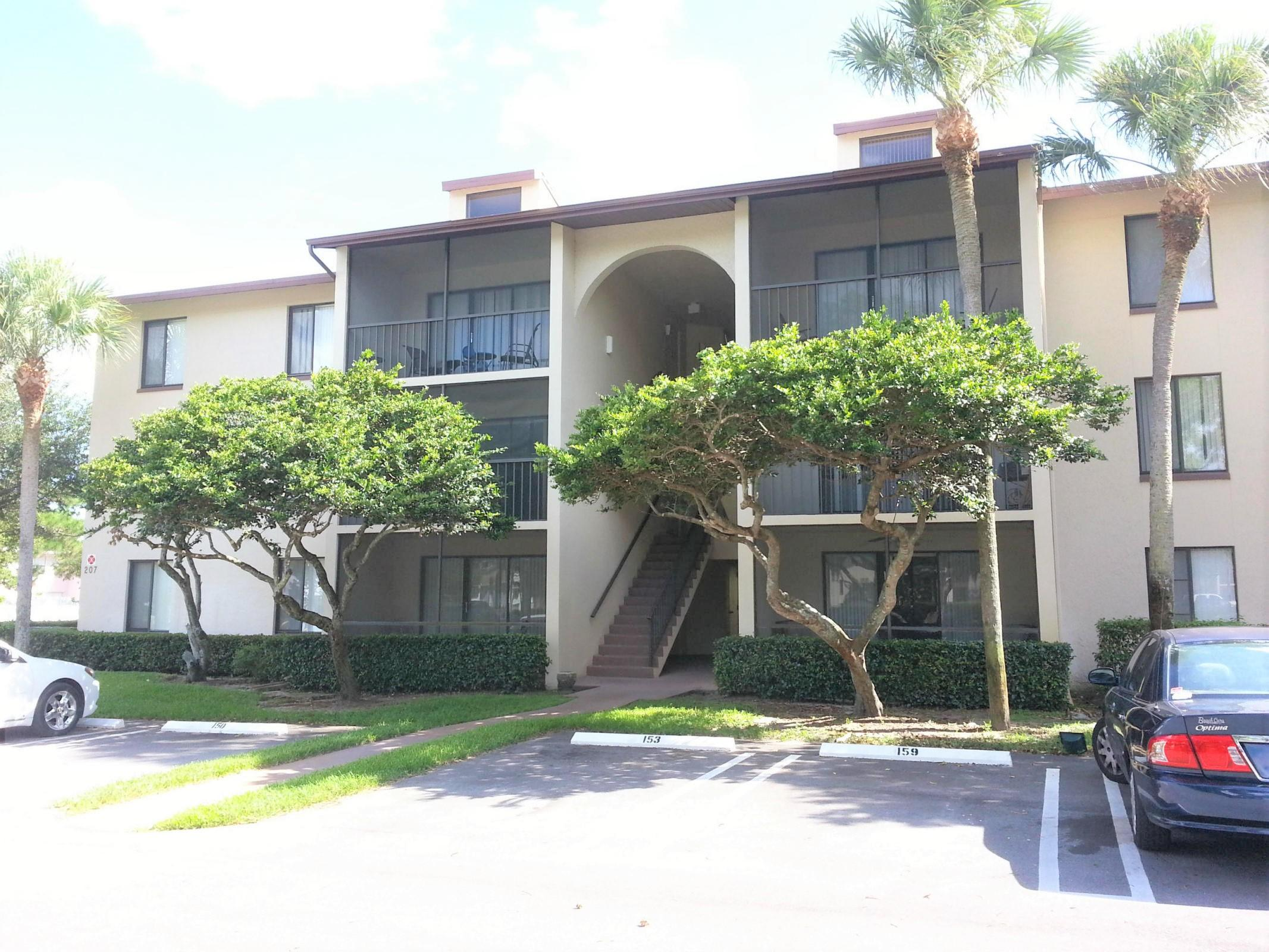 Photo of home for sale at 207 Foxtail Drive, Greenacres FL