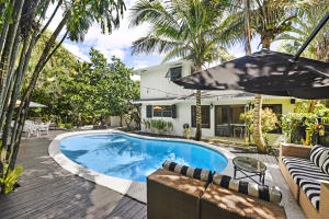 Hypoluxo Island Charm & Sophistication. This 3 bedroom, 3 1/2 bath pool home sits one home from intracoastal waterway and offers water views. Each room in this charming home is generously sized offering plenty of space for you to live in.  Entertaining will be a breeze ease between indoor and outdoor living featuring a sparkling private pool and fire pit. Youll fall in love from the moment you drive up with lush landscaping and a beautifully freshly painted home. Easy access to beach, restaurants, shopping, grocery & highways. Bike or walk to all of it! Ready for you to enjoy and live the sunny Florida lifestyle.