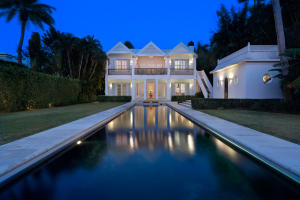With the ambiance of an idyllic resort villa, this casually elegant island-inspired paradise captures gorgeous views on wide Intracoastal waters backed by the sunset. Finished with fine millwork, the fresh, light interiors feature versatile living spaces on both levels plus privately arranged bedroom suites with ample room for guests. The outdoor oasis has a 70+/--foot lap pool, cabana with steam room, and boat dock. The information herein is deemed reliable and subject to errors, omissions or changes without notice.  The information has been derived from architectural plans or county records. Buyer should verify all measurements