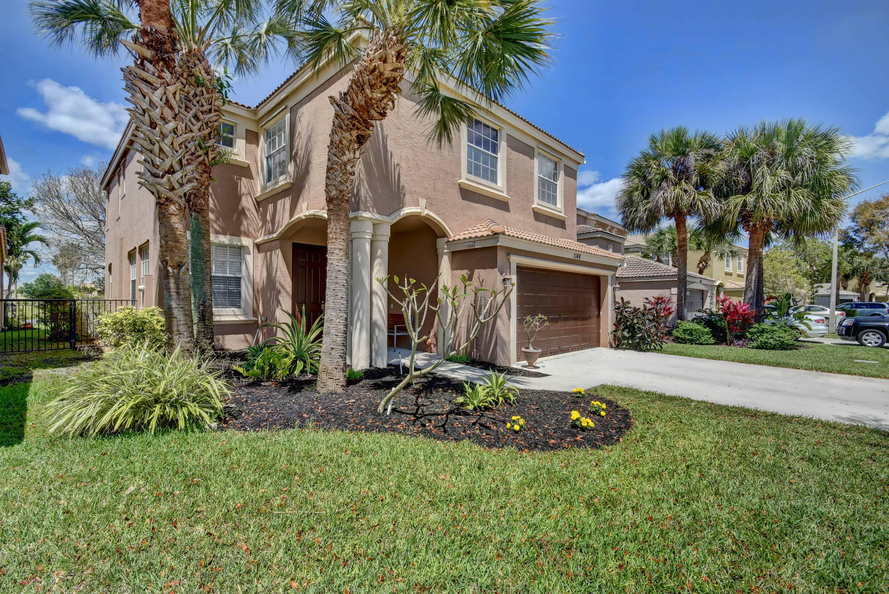 1148 Oakwater Drive Royal Palm Beach, FL 33411