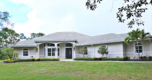 2885 SE Ranch Acres Circle , Jupiter FL 33478 is listed for sale as MLS Listing RX-10527831 59 photos