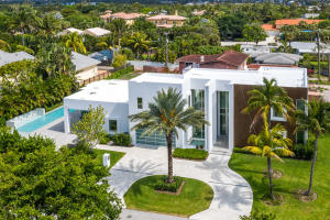 This is the Ultimate in Newly Constructed Contemporary Living in Upscale Ocean Ridge. Designed by well-known architect, George Brewer, this 4,850 SF modern masterpiece, located on a corner lot offers 5/BR and 4.1/BA with an interior layout that will take your breath away.  From the entry level foyer to the homes open floor plan youll be impressed with the soaring ceilings and high walls that are perfect for the display of your personal artwork and wall decor. The living/great room flows directly to the formal dining area making the home perfect for entertaining family and friends. Just off the main floor is the very private master suite with a large walk-in closet and a master bath featuring dual sinks, tub with spa and separate shower. Just a block from the beach in Ocean Ridge.