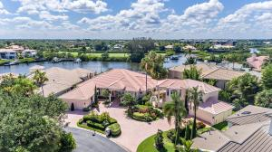 Once in a lifetime Estate opportunity located on one of the largest water-front lots in all of Jonathans Landing. This incredible double lot boasts one of the finest views on Casseekey Island!! Stunning expansive water views of the famous ferry and 17th fairway.The curb appeal is second to none as you approach the large circular motor court.The main home has three separate suites, amazing office and craft room. Your breath will be taken away as you enter the grand foyer. The impressive living room has magnificent views and 18-foot ceilings. The remodeled kitchen has a full bar, large butler pantry and sub-zero refrigerator. The spacious master suite has a gorgeous master bath, two large walk in closet with an additional cedar closet for the lady of the house.