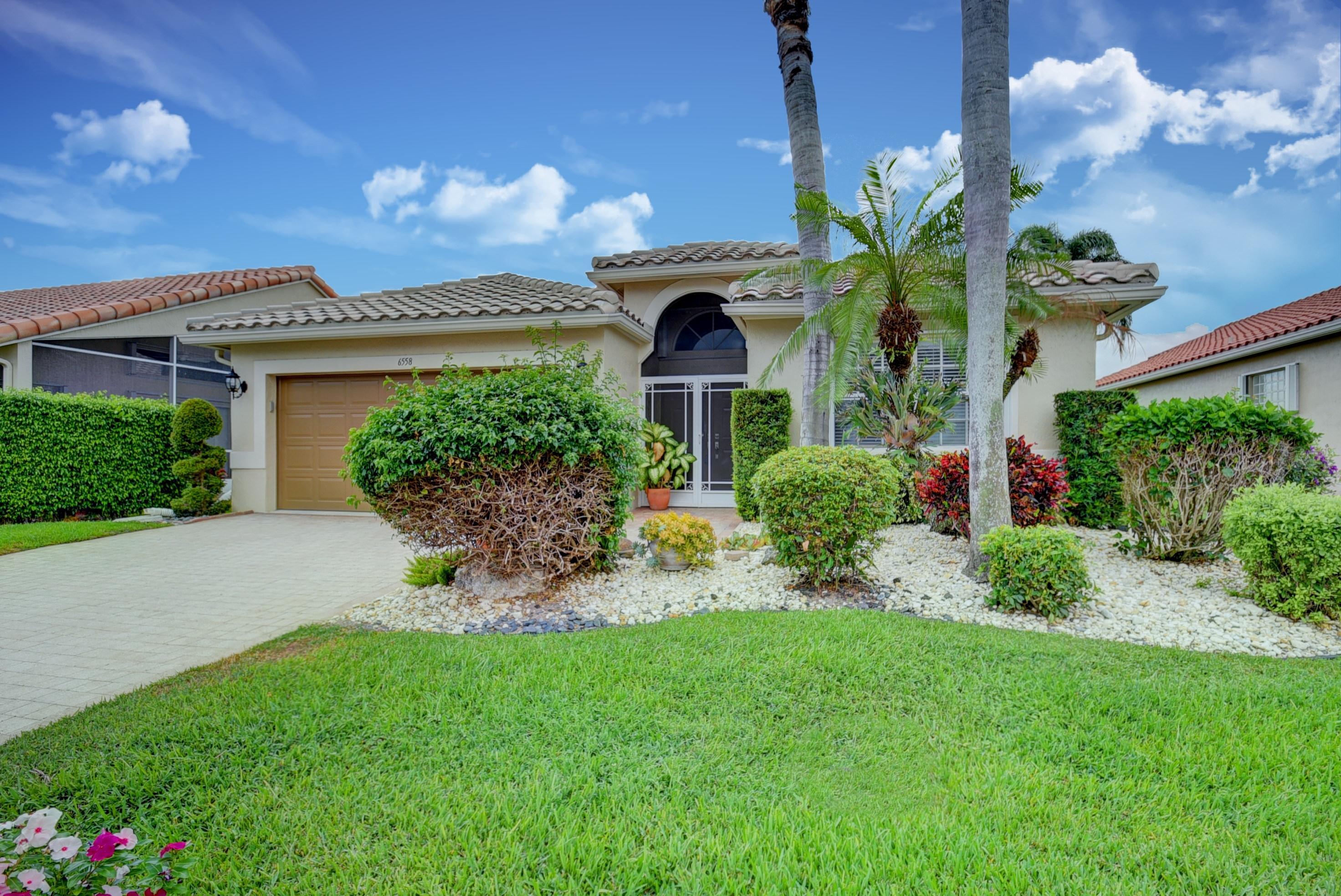 Photo of home for sale at 6558 Sherbrook Drive, Boynton Beach FL