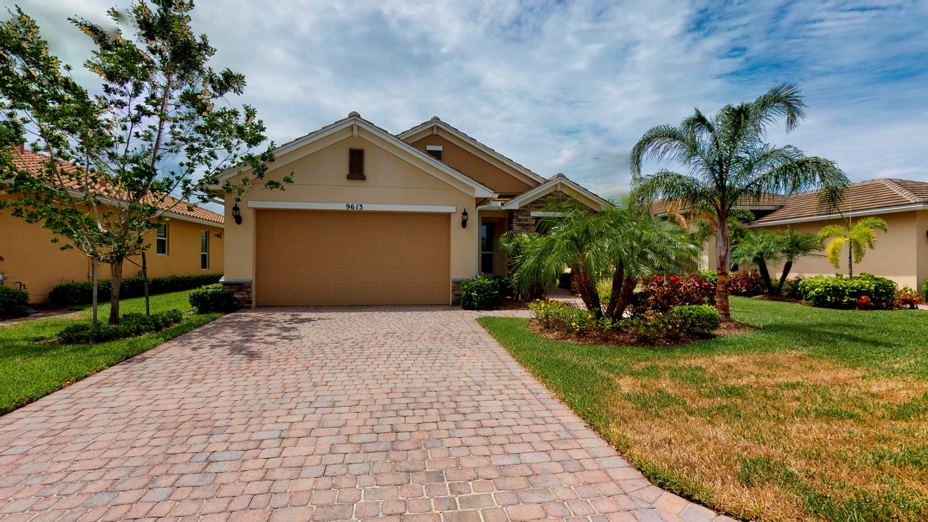 Photo of home for sale at 9613 Royal Poinciana Drive SW, Port Saint Lucie FL