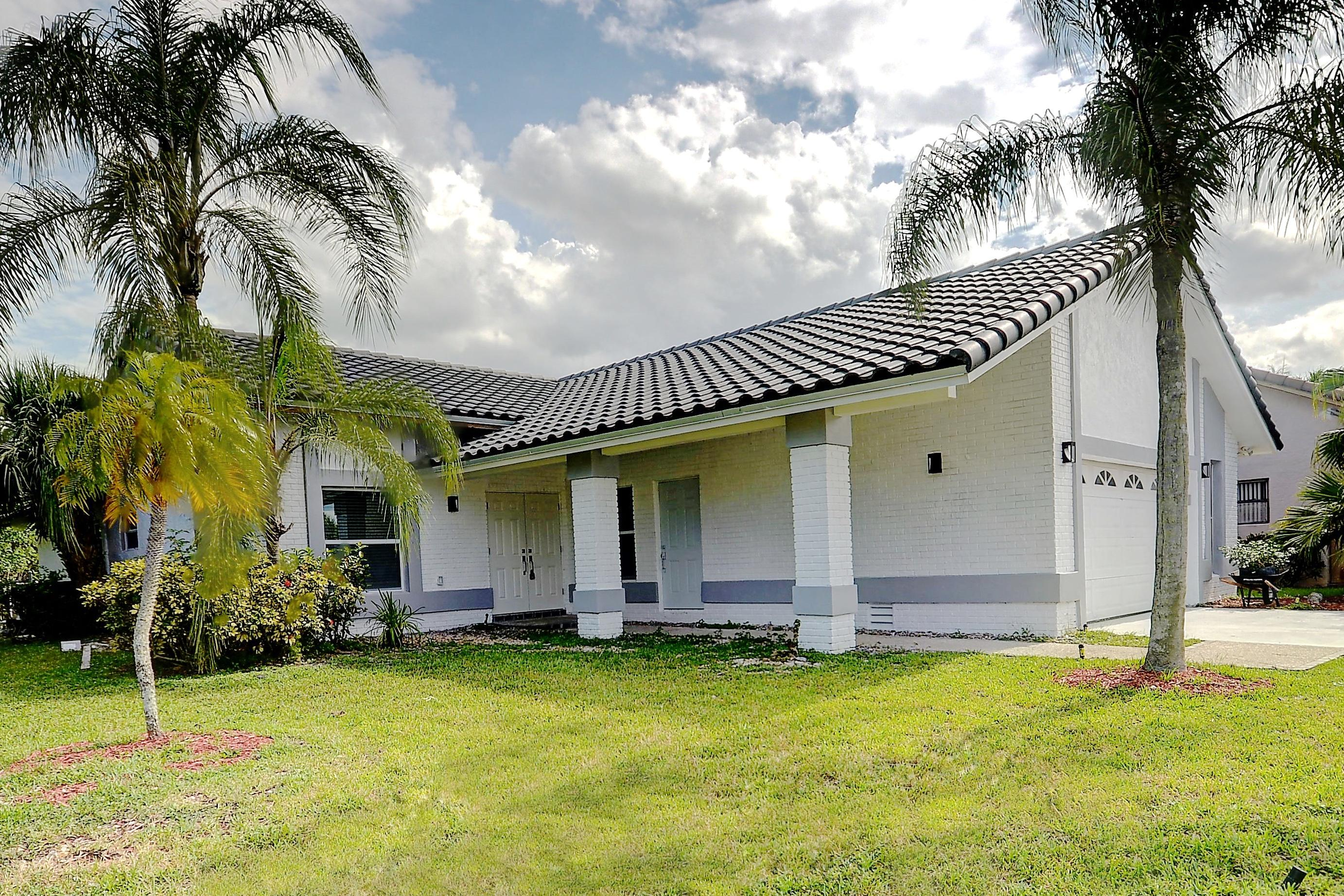 Photo of home for sale at 10236 Harbourtown Court, Boca Raton FL