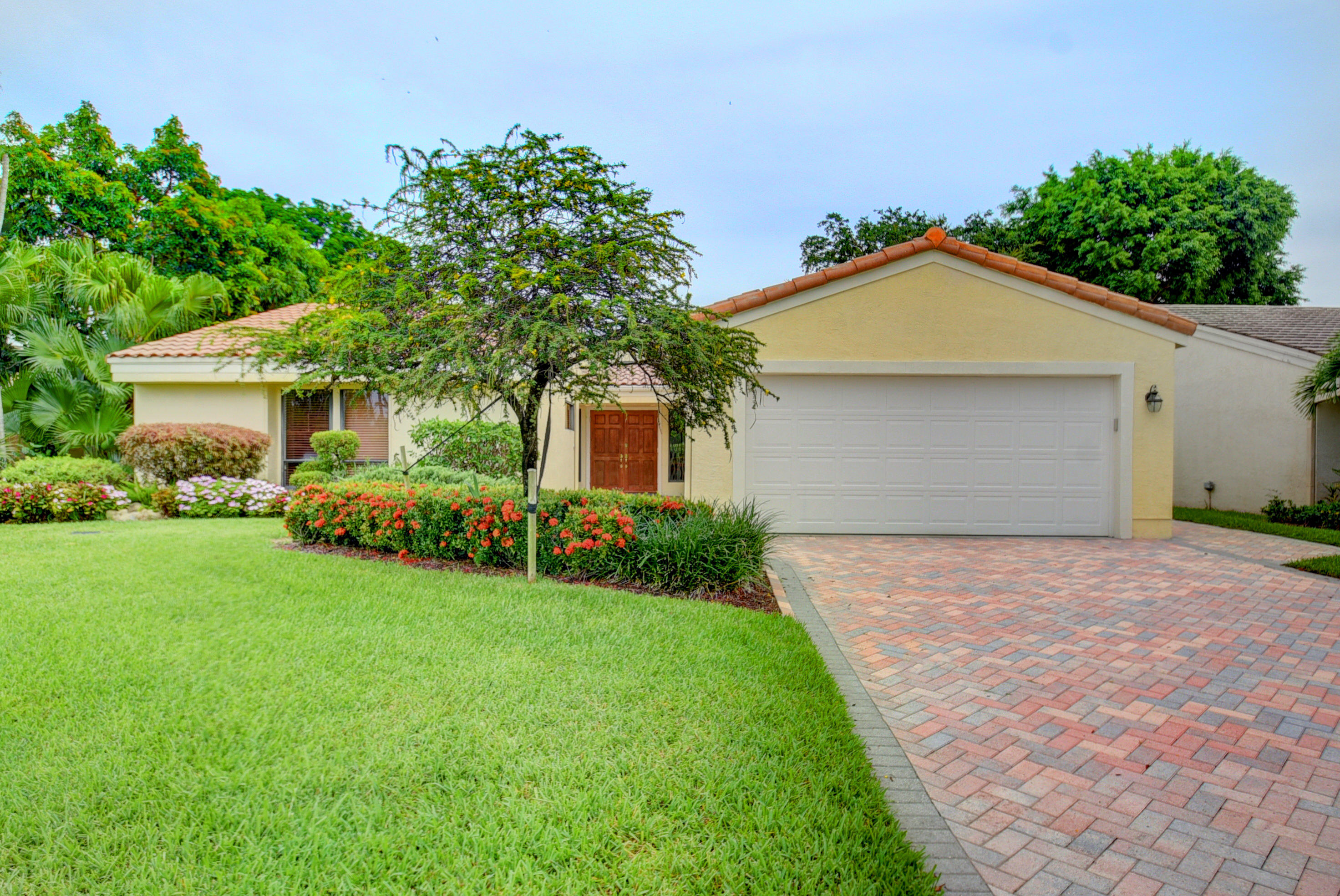 Photo of home for sale at 7161 Woodbridge Circle, Boca Raton FL