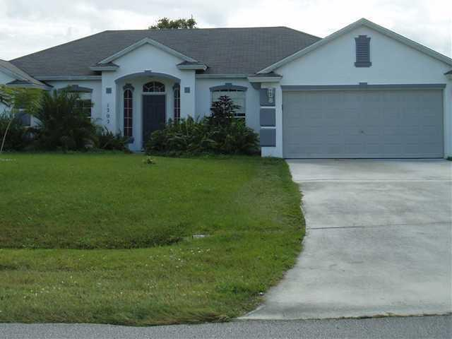 Photo of home for sale at 1202 Glastonberry Avenue SW, Port Saint Lucie FL