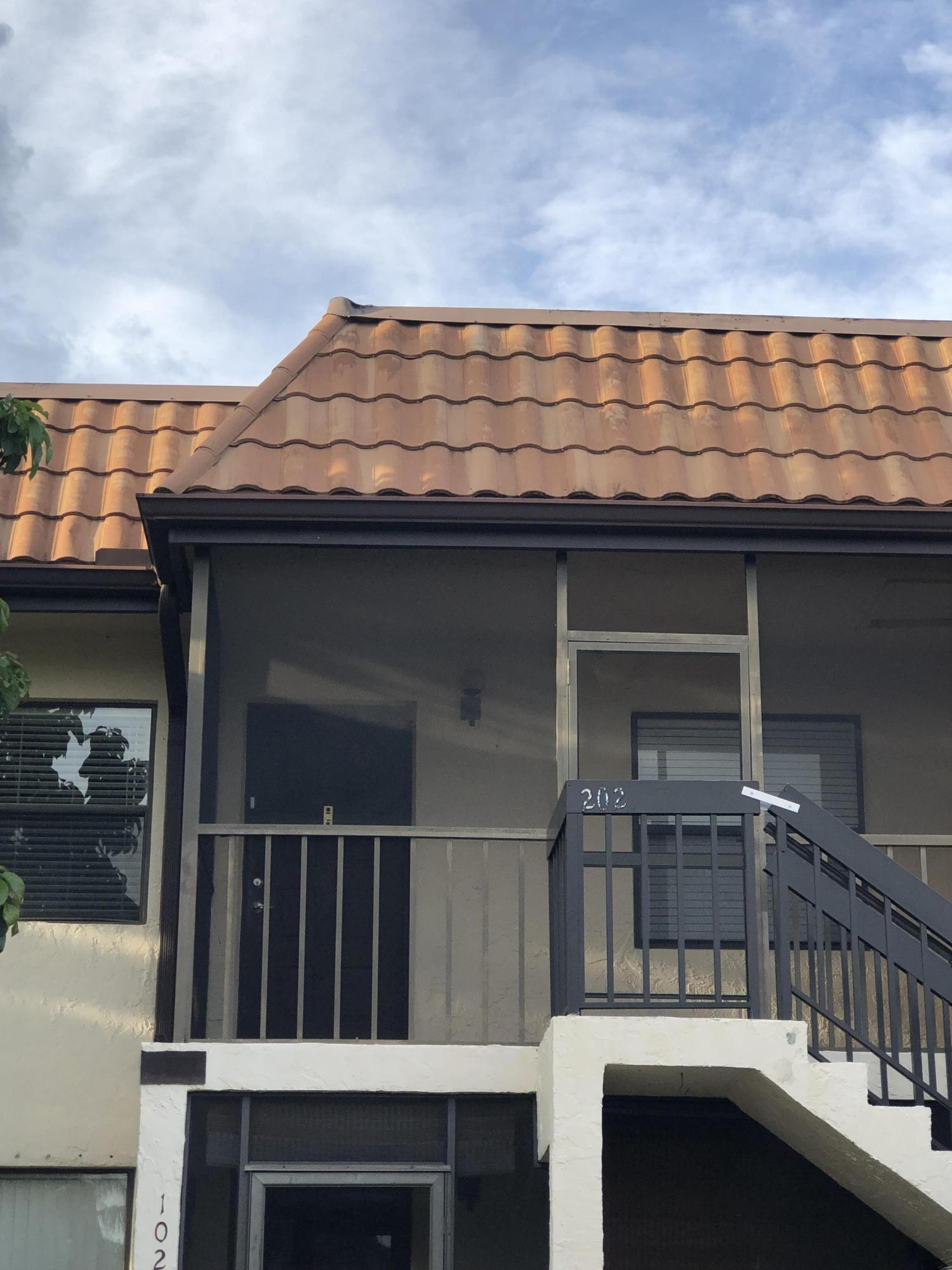 Photo of home for sale at 7173 Golf Colony Court, Lake Worth FL
