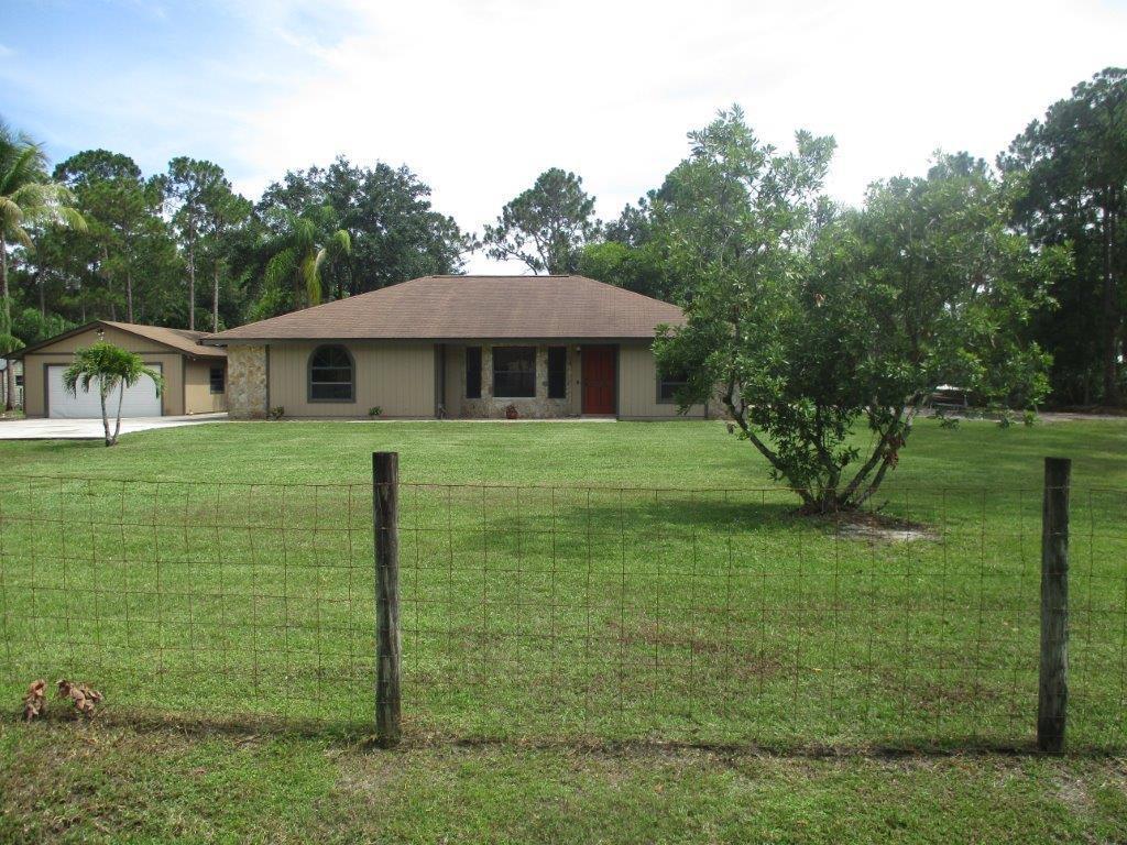 Photo of home for sale at 13804 153rd Road, Jupiter FL