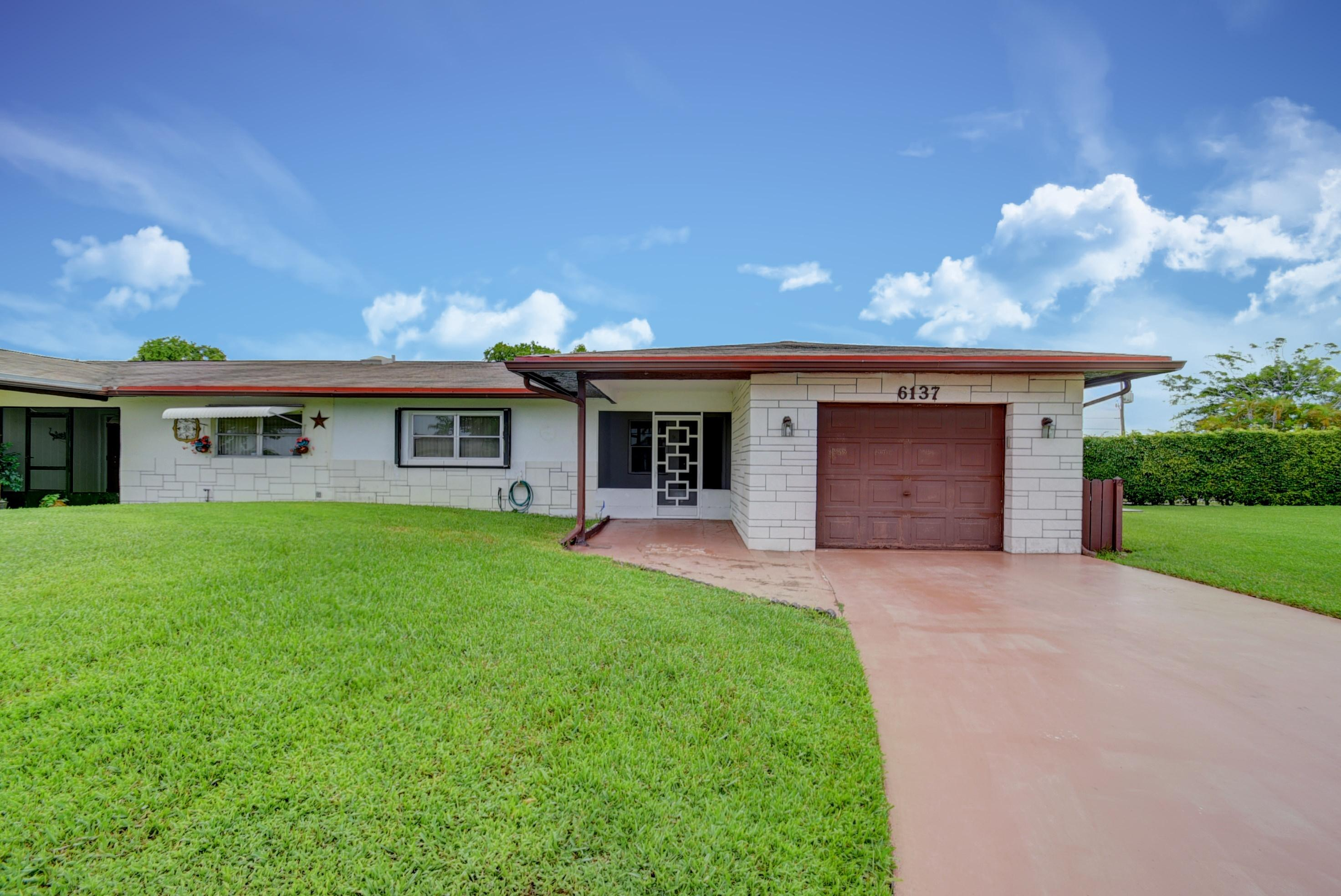 Photo of home for sale at 6137 Overland Place, Delray Beach FL