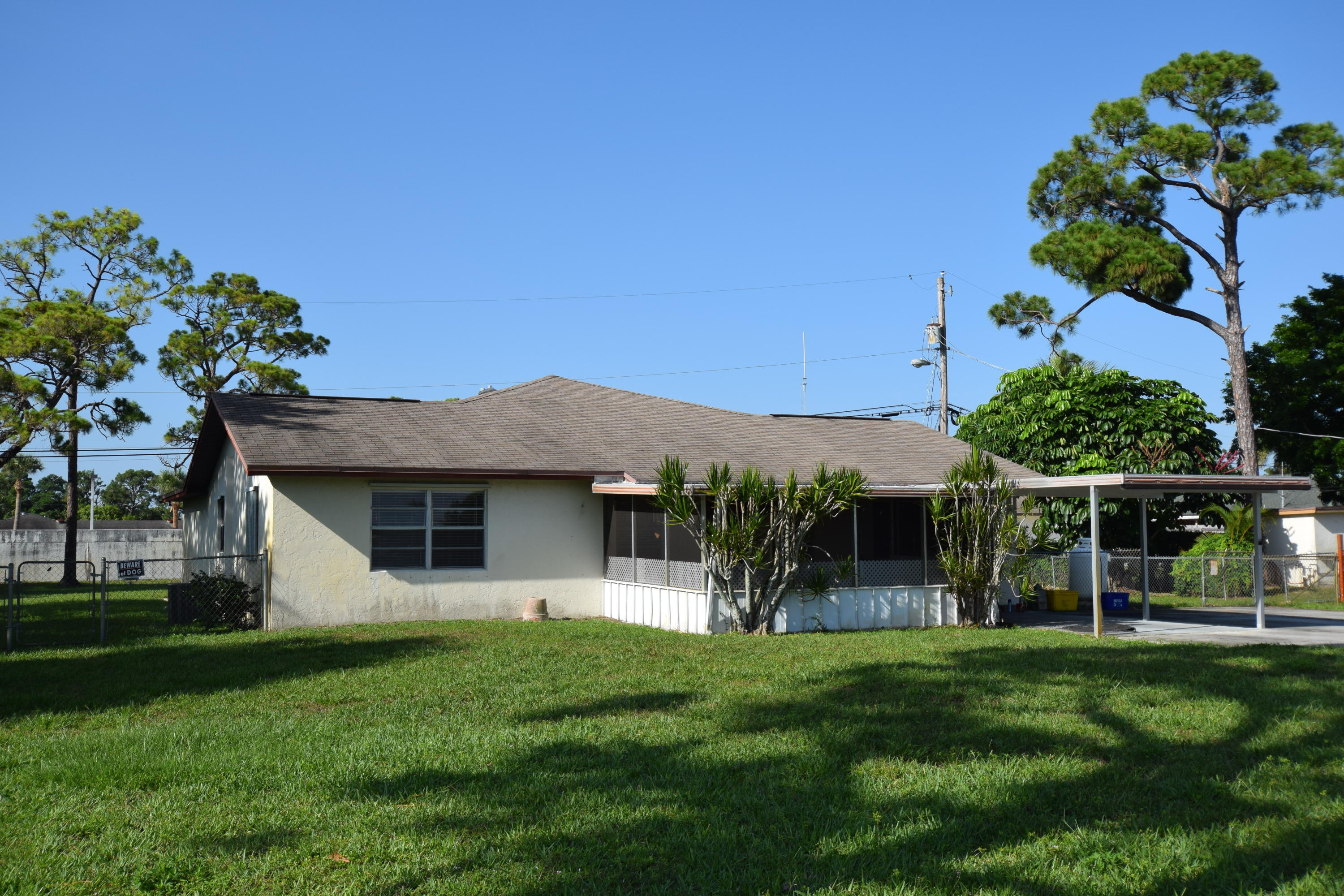 Photo of home for sale at 3940 Canal 9 Road, Palm Springs FL