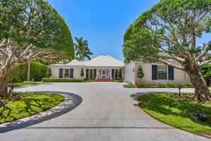 Set in the heart of Gulf Stream, this elegant Bermuda style home is ideally situated on a wide canal with excellent water views and a 23 foot dock.The orientation of the home is facing south which offers sun filled rooms,  a beautiful pool area and a 19X32 foot awninged terrace.With 4 bedrooms and five full baths, it is a wonderful family home or perfect for visiting guests.Entering through a lovely foyer to the living room, one can view the pool and canal. There is a formal dining room and den with fireplace and an over sized kitchen with room for a dining table.This is Florida living at its best!