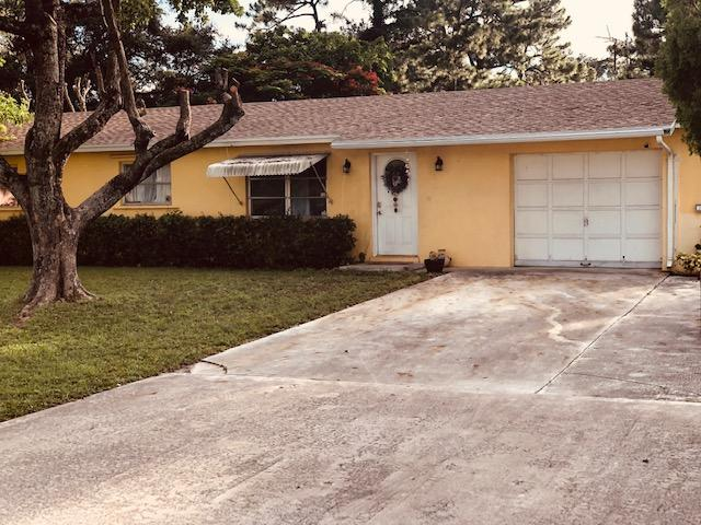 Home for sale in PALM BEACH FARMS CO PL 7 Lake Worth Florida