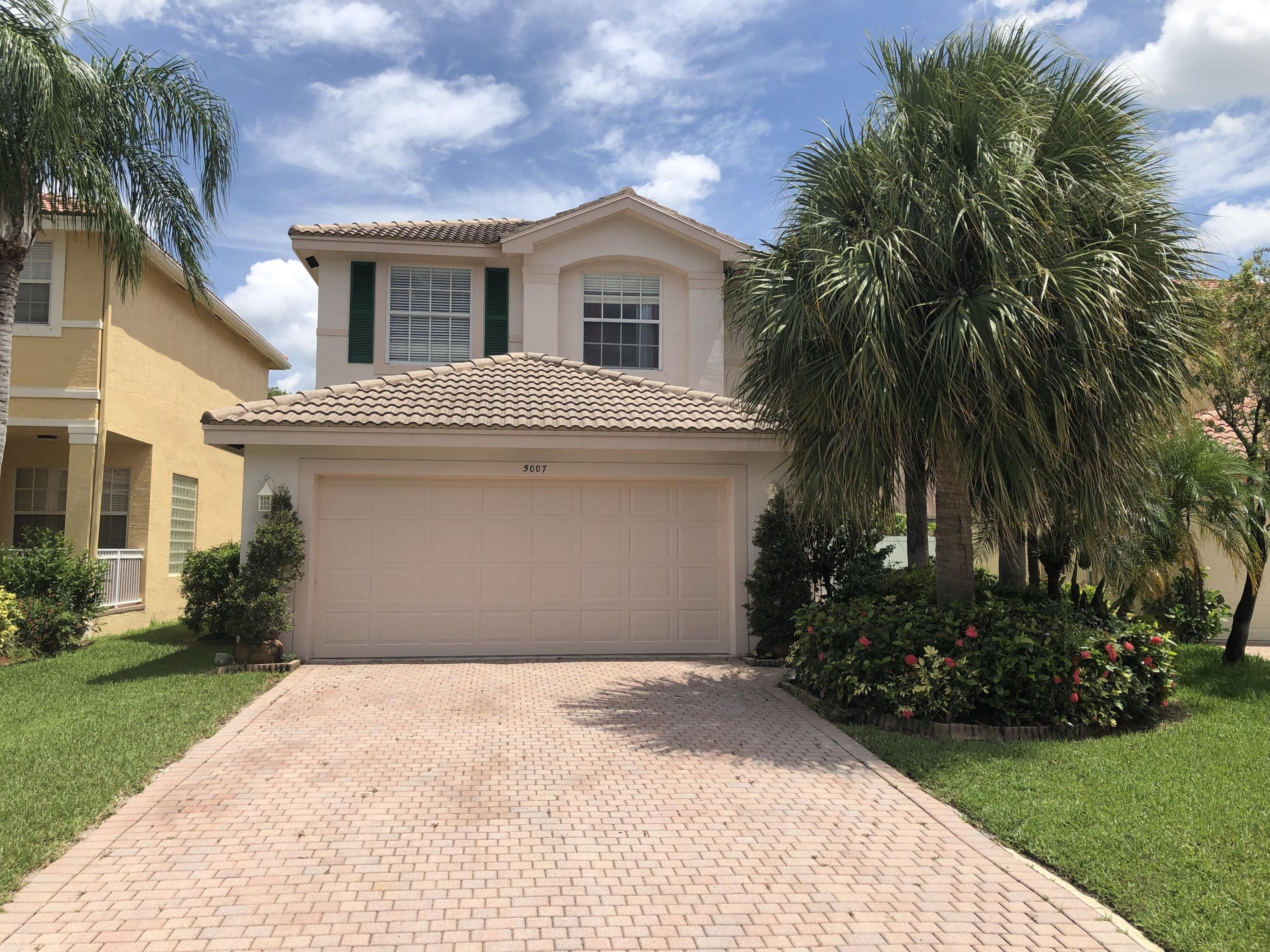 Photo of home for sale at 5007 Northern Lights Drive, Greenacres FL