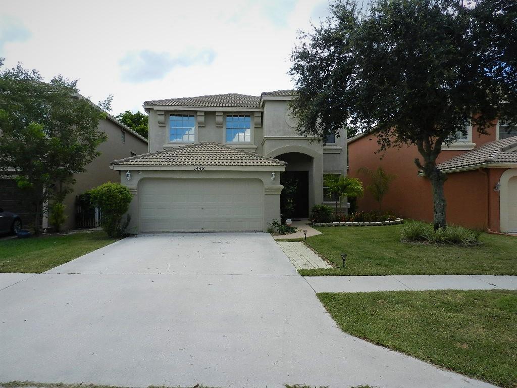1448 Briar Oak Court Royal Palm Beach, FL 33411