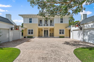 This Stunning British West Indies style home is newer 2010 construction and sits on a 1/2 acre in Jupiters sought after PENNOCK POINT. Meticulously designed w/ no detail missed. Chefs dream w/ top of line professional gas SS stove/grill. Large granite island workspace, counter seating, wide plank wood floors throughout and coffered volume ceilings. First floor Master bedroom has his/her closets and water closets. Four spacious Guest suites. Other features include Solar panels, electronic security driveway gate. Two (2) car garages and central vac. Outdoor tropical oasis with butterfly garden, oversized pool, expansive summer kitchen, firepit and cabana bath w/ shower. Impact glass through-out. Whole house generator w/ 500 gallon in ground propane tank. A Perfect family home! A MUST SEE!