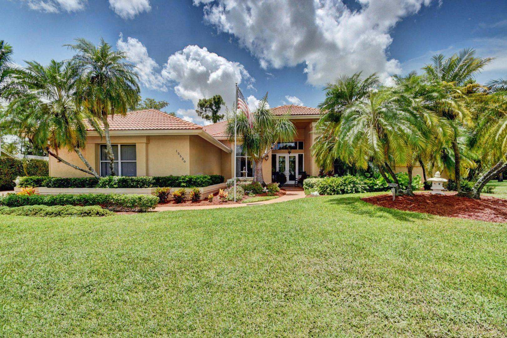 Photo of home for sale at 15530 Woodmar Court, Wellington FL