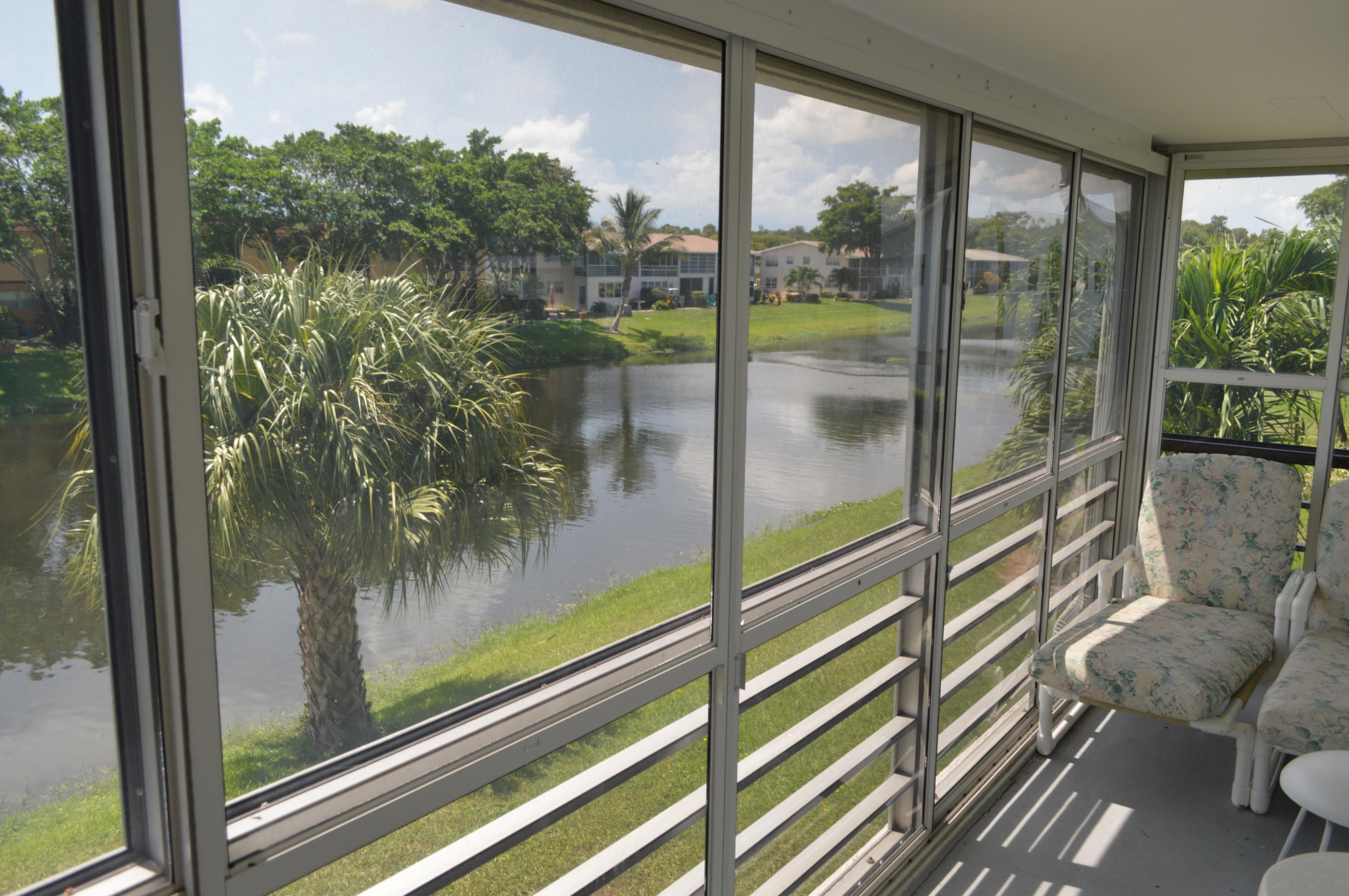 A lovely 2 bedroom 1 1/2 baths END UNIT with additional windows to let in the sunlight.  This furnished Condo has a brand new AIR CONDITIONER installed in July of 2019.  Canal views from the spacious covered and screened balcony and plenty of room in the walk-in closet. Come and enjoy all that this Community has to offer.  55 and over community.  Lamps and pictures on walls and personal items do not convey.