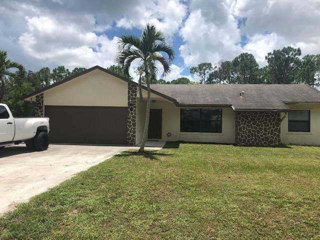Photo of home for sale at 14196 77th Place, Loxahatchee FL