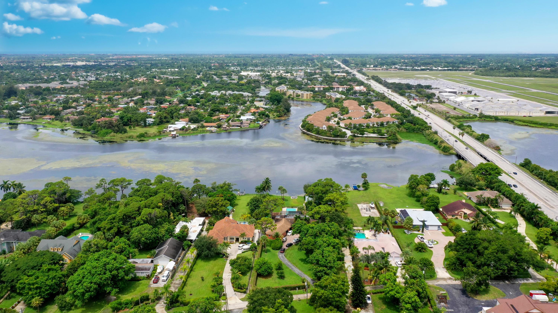 LAKE OSBORNE PARK  LTS 7 & 8 LYG W OF PINE DR &  TR OF RECLAIMED LAKE BOTTOM   LAND ADJ THERETO IN TIIF DEED