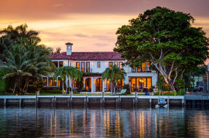 Stunning California-inspired Everglades Island estate. Custom built in 2016. Designed by Roger Janssen with open floor plan, soaring ceilings, beautiful flooring, and gorgeous architectural detailing throughout. Overlooking the Intracoastal with romantic views of the Tarpon Island Bridge. Features 4BR/4.2BA with library, gym, 3 car garage, and expansive club room with pool table, bar, and fireplace. 8,500+/- total square feet with wine cellar, elevator, and smart home system. Living room with stone fireplace leads to formal dining room. Chefs eat-in kitchen opens to waterfront family room. Oversized Master Suite features fireplace, balcony, & beautiful baths. Fantastic outdoor spaces include front gated courtyard with fountains, rear giant banyan tree, fire pit, loggia, pool, spa, & dock.