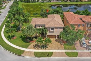 Nestled in a luxurious community, very close to Wellington border & A-rated schools sits this oversized, glamorous & Unique water-front home. Abundance of upgrades & amenities galore. Home offers extremely LOW HOA fees & plenty of 1st class sqft. Sweeping high tray ceilings, 20 x 20 porcelain tiles,12ft ceilings & arch entryways all leading to rooms finished w/state of the art perfection. Updated  gourmet kitchen boasts every amenity you can imagine while overlooking a sprawling waterfront backyard.1st fl Master Bd offers extensive sqft, tray ceilings & has 2 cstm walk-in closets & large elegant Master Bth w/separate soaking tub & walk-in shower. 5th bedroom/office/den also on 1st fl. 3 beautiful 2nd fl bds w/ their own upgraded baths plus a large entertainment room w/a granite wet bar.